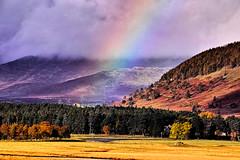 Spey water meadows near Laggan (Fr Paul Hackett) Tags: river rainbow meadow pines trees mountain clouds
