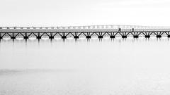 Lisbon bridge - take 1 (ignacy50.pl) Tags: river bridge water construction architecture lisbon portugal cityscape landscape people blackandwhite monochrome reportage travel journey sightseeing minimal minimalart minimalism