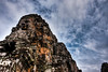 many face god (kaimonster) Tags: cambodia ruins temple stone sky sculpture asia angkorthom day