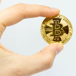 Bitcoin in a hand and white background thumbnail