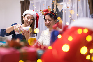 Young couple enjoying Christmas party at home