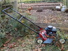 Lawn Mower. (dccradio) Tags: mountairy mtairy md maryland outdoors outside leaf leaves autumn fall foliage pushmower mower lawnmower handle chicken chickencoop hen hens bird nikon coolpix l340 bridgecamera