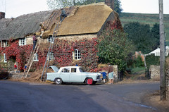 New Street Lane, Loders, Dorset (foundin_a_attic) Tags: eveyday life 1970s mending thatch roof uk 1969 1970 newstreetlane loders dorset morrisoxford thatcher