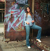 Giulia 7 A (neohypofilms) Tags: portrait gritty color hippie retro 70s blue colours graffiti shoes clogs mules socks stockings jeans denim paint hair tall long rust urban hasselblad art city cleveland medium format 120