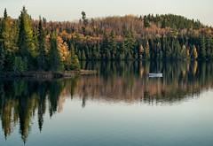 'The Fisherman' (Canadapt) Tags: lake shoreline boat man fisherman reflection autumn fall calm mirror keefer canadapt