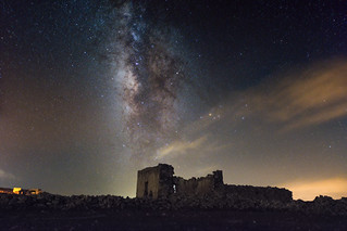 Milky way above abandoned house