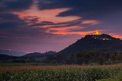 Korat Travel Destination - Temple on the Mountain. (baddoguy) Tags: architecture beauty in nature buddhism building exterior built structure cloud sky color image country road domination dramatic dusk famous place hill range horizontal idyllic korat landscape local landmark meadow mountain multi colored nakhon ratchasima province national no people northeast on top of outdoors photography plateau religion rice paddy rural scene solitude southeast asia sunset temple thai culture thailand tourism tranquility travel destinations wat