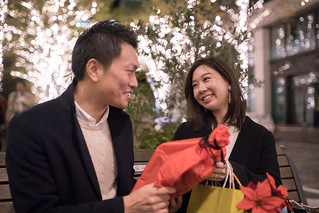 Happy young wife receiving gift from husband