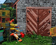 A Lobsterman's Backyard (pandt) Tags: marblehead massachusetts newengland lobsterpots buoys colors red yellow blue green shack barn shed doors weathered ocean sea coast coastal fishing traps canon slr eos 7d outdoor buoyant