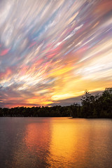 Sunset Sparks (Matt Molloy) Tags: mattmolloy timelapse photography timestack photostack movement motion colourful sky sunset clouds trails lines water reflection trees haskinspoint littlecranberrylake seeleysbay ontario canada landscape nature countryside lovelife