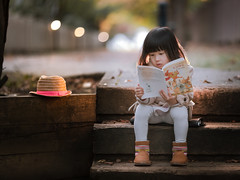 reading girl (michaelinvan) Tags: book lantern candle girl reading dusk bokeh canon 5d2 135mm f2