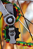 Geared up for colour (James_D_Images) Tags: bicycle chain derailleur wheel spokes colourful green yellow red closeup bokeh grass sky abstract gears