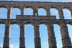 Aqueduct - Segovia, Spain (Marian Pollock (Weiler)) Tags: europe spain segovia aqueduct bridge plaza sky brickwork roman ancient historical statue