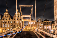 Bridge and light trail @ Haarlem (PaulHoo) Tags: evening night nightphotography nikon d750 wideangle city urban neon light sky clouds longexposure building architecture bridge haarlem holland netherlands 2017 cityscape spaarne lighttrail
