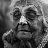 I will keep waiting for you (Ales Dusa) Tags: woman face outdoor bw blackandwhite canon5d ef70300mmf456lisusm streetportrait streetshot candid oldwoman sadwoman wrinkles glasses necklace alesdusa strongcontrast dramaticportrait ring