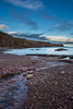 Pebbled Beach (EricHarden) Tags: scotland beach auchmithie seascape sea pebbles blue water clouds sky nikon nikkor 18200mm