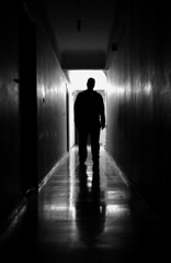 Footing (Eleni Maitou) Tags: nikond90 nikon silhouette standing man streetphotography street bnw blackwhite bw corridor black shadow light reflection