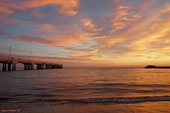 Tramonto al pontile di Marina di Massa (Darea62) Tags: sunset seascape skyscape nature landscape skyporn bridge pier jetty marinadimassa tuscany toscana tramonto streetlights panorama paesaggio travel