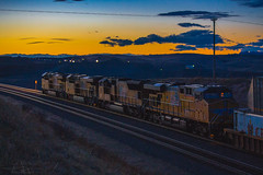 Racing into the Sunset (Troy A. Snead) Tags: overlandroute sunsets photography unionpacific shermanhill granitewyoming valley railfanning laramiesubdivision transcontinentalrailroad colorful intermodaltrains