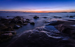 In the Last Light (tinamar789) Tags: sea seashore seascape sunset sky wind stormy rocks last light landscape blue hour horizon autumn lauttasaari helsinki finland