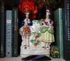 Staffordshire figures (Celeste33) Tags: staffordshirefigure highland bird musicalinstrument fauxclock garden windinstrument clarinet grapevine parrot