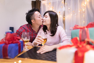 Young husband kissing to wife at Christmas night