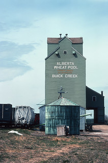 Using a grain elevator as a photo prop in Buick Creek, BC on May 25, 1992 -- 3 Photos