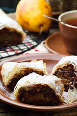 Pears and chocolate   strudel. .selective focus. (Zoryanchik) Tags: strudel pear food dessert sweet pie cuisine pastry sugar traditional fruit tasty cinnamon white gourmet slice homemade nobody delicious baked piece background roll austria chocolate
