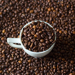 Coffee cup filled with coffee beans thumbnail