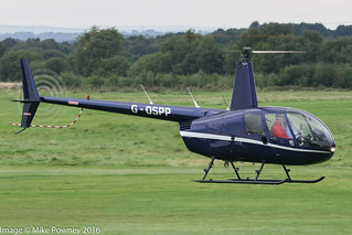 G-OSPP - 1999 build Robinson R44 Clipper, crossing the active, inbound to Barton