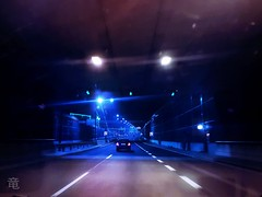 ride for the blue light at the end of the tunnel [explored] (Ola 竜) Tags: road tunnel bluelight car drive ride driverspov samsunggalaxys7 highway street urban modern signs traffic lights lines night dark dusk evening vehicle movement