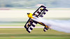 Low level knife edge (hepic.se) Tags: low level knife edge aerobatics pitts model12 thor scandinavian airshow stripes purple smoke stunt pilot aeroplane biplane propeller longexposure aircraft airplane