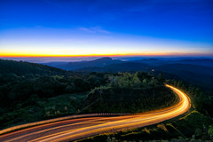 Sunrise scence of car light trail to the top with curve of road at Doi Inthanon National park in Chiang Mai Province, Thailand. (MongkolChuewong) Tags: asia autumn background beautiful beauty blue car chiang chiangmai cloud curve dawn day doi environment foggy fresh green high highway inthanon landmark landscape light lighttrail mai mist mountain national natural nature outdoor park road scene scenic sky summer sunlight sunrise sunset thailand trail tranquil travel tree vacation view white