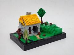 Puerto Desafio Blacksmith Shop (Robert4168/Garmadon) Tags: lego micro build blacksmith thatched roof green hills fence brown waterwheel eslandola brethrenofthebrickseas puerto desafio