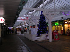 North Walk (southglosguytwo) Tags: 2017 buildings december hometown southgloucestershire yate yateshoppingcentre northwalk signs shops fence decorations christmastree variouspeople
