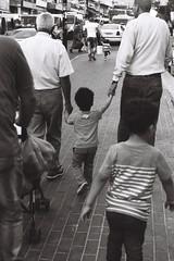 Analog - Arab men with children (Maximilian_Norrmann_Photography) Tags: palastine palästina israel arab arabworld ramallah analog sw bw foto photography old street children kids father kinder streetphotography