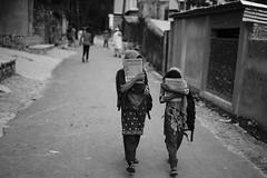 No reason to be ashamed (A. adnan) Tags: neighbourhood neighbour chittagong girls education bangladesh school shy two together walking funny street dailylife
