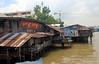 shacks along the Chao Phraya river (_gem_) Tags: travel bangkok thailand asia southeastasia chaophrayariver chaophraya river water shacks houses city street urban