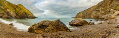 Llanlleiana (urfnick) Tags: beach pebbles stones cliffs cove llanlleiana angelsey northwales canon eos 1300d efs1018mm panorama waves splash