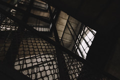 From the Dark Shallows (Thomas Listl) Tags: thomaslistl color stairs staircase moody dark grid window house building architecture diagonal graphical shallow wideangle budapest hungary pov vanishing vsco 24mm lowlight