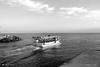 SI VA PER MARE ! (Salvatore Lo Faro) Tags: porto capoiale puglia italia italy barca peschereccio pesca mare cielo lavoro fatica canale bianco nero salvatore lofaro canon g 16
