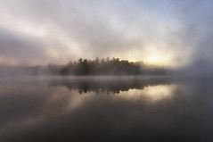 Land, ho! (mystero233) Tags: land landscape tree trees forest woods water lake reflection fog mist morning dawn yellow sun nature outdoor north america canada muskoka ontario visibility