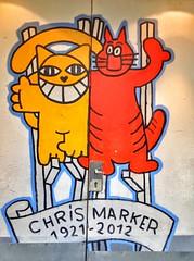 Tribute to Chris Marker on a door 🚪 (LUMEN SCRIPT) Tags: door colours paris street «streetart» «thomavuille» «monsieurchat» vivid colour color