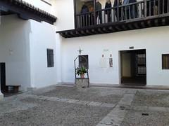 Antezana Hospital, founded 1483, Alcala de Henares , Madrid (d.kevan) Tags: spain madrid alcaladehenares hospitaldeantezana woodwork pillars decorativedetails details verandahs courtyards people wells seats paving