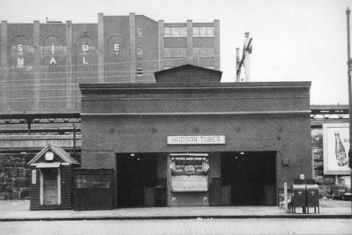Another one for my Jersey City friends. This was the PATH station (still the Hudson and Manhattan Tubes at the time) by Exchange Place near the Hudson. The Pennsylvania Railroad is right behind it. The Harborside Terminal hovers in the background. 1951
