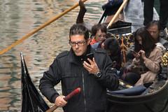 Venice: Gondolas and Smartphones (hutchtheman) Tags: gondola venice smartphone gondolier phone chinesetouristsontheirphones