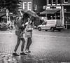 Dutch Weather (Emil de Jong - Kijklens) Tags: amstetrdam rain regen paraplu blackandwhite zwartwit kijkenmetkijklens kijklens nieuwmarkt weer