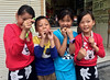 Kids and Toy Snakes (cowyeow) Tags: shennongjia hubei urban asia asian china chinese street town city people muyu village girl woman chinesegirls pretty cute smile children child kids littlegirl snake snakes toy giggles funny portrait funnychina