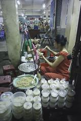 around the market (kuuan) Tags: chợphúnhuận caothắng voigtländerheliarf4515mm manualfocus mf voigtländer15mm aspherical f4515mm superwideheliar sonynex5n apsc hochiminhcity hcmc saigon vietnam street market yoghurt flan tofu drinks