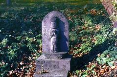 Buddhas on the ground (threepinner) Tags: buddha mikasa hokkaidou hokkaido northernjapan japan autumn pentax me rikenon 50mm f17 negative iso100 selfdeveloped negaposidevelopment reversal 観音山 三笠 北海道 北日本 日本